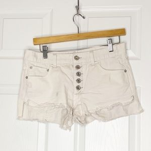 Free People button fly distressed white shorts